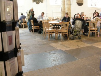 Interior of St Michael Spurriergate, York, with people at cafe.